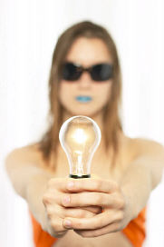 A woman holding a lighbulb
