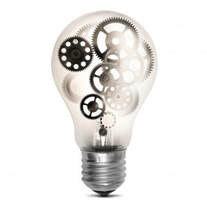 Lightbulb filled with cogs: Metaphor for complexity of requirements